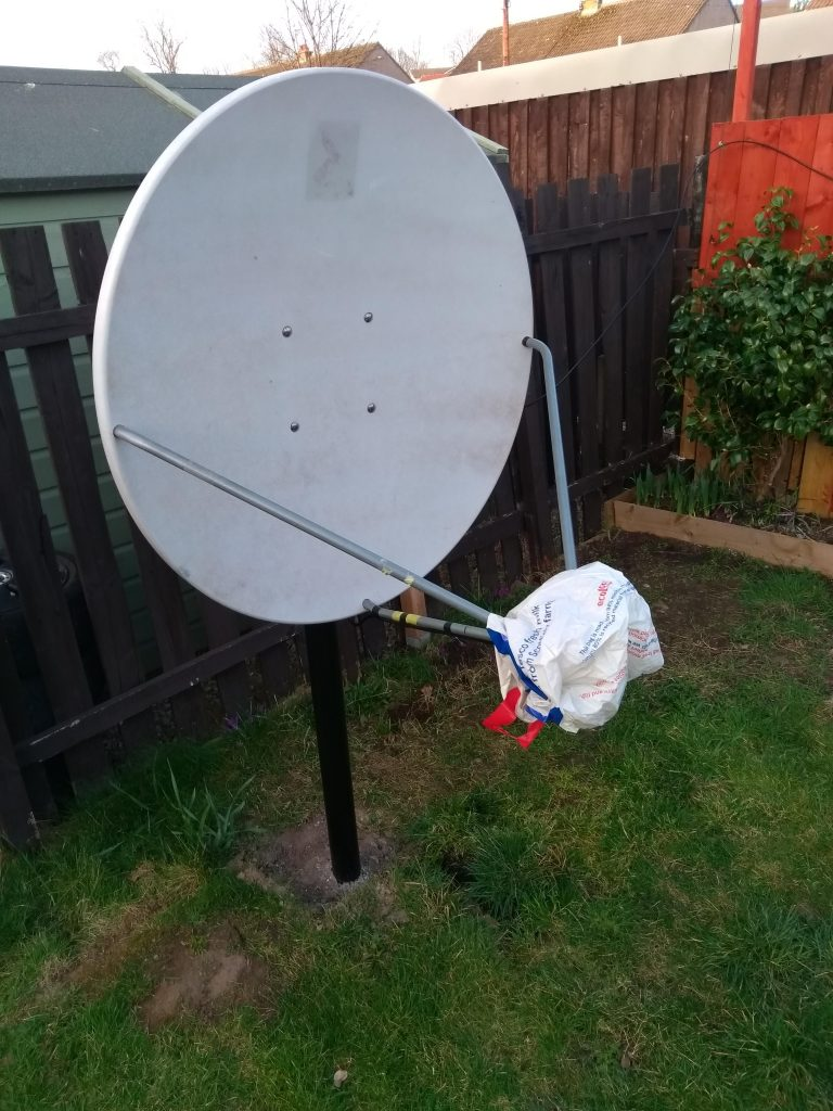 Channel Master 1.2m offset dish in the back garden, on a 6ft steel pole.